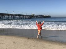 Boy playing on the beach Stock Image