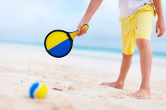 Boy playing beach tennis Royalty Free Stock Photo