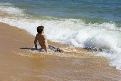 Boy is playing  in a beautiful sea Royalty Free Stock Photos