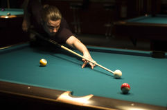 Boy playing billiard. Boy preparing to play some balls in billiard game stock image