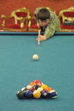 boy playing billiards Royalty Free Stock Photography