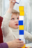 Boy playing with blocks Stock Photos