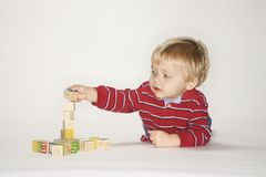 Boy playing with blocks. Stock Images
