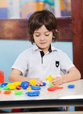 Boy Playing With Blocks In Classroom Royalty Free Stock Image