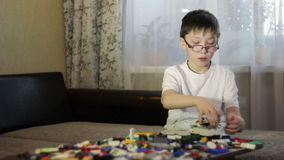 Boy playing with blocks. stock footage