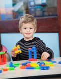 Boy Playing With Blocks In Kindergarten Stock Photos