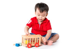 Boy playing with blocks royalty free stock images