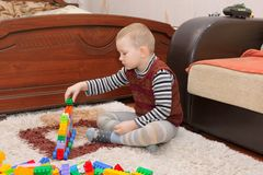 Boy playing on the floor Royalty Free Stock Photos