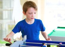 Boy playing board football. Little boy playing board football Royalty Free Stock Images