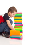Boy playing with books Royalty Free Stock Photos