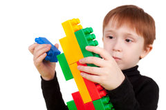 Boy playing with the bricks Stock Images