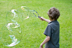 Boy playing with bubbles Stock Photography