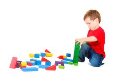 Boy playing with buiding blocks Stock Photos