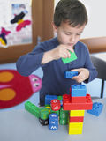 Boy Playing With Building Blocks In Class royalty free stock photos