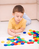 Boy is playing with building blocks. Cute little boy is playing with building blocks Royalty Free Stock Photo