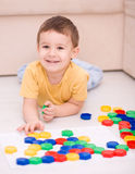 Boy is playing with building blocks. Cute little boy is playing with building blocks Royalty Free Stock Image