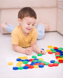 Boy is playing with building blocks. Cute little boy is playing with building blocks Stock Photography