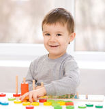 Boy is playing with building blocks. Cute little boy is playing with building blocks Royalty Free Stock Images