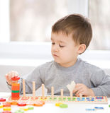 Boy is playing with building blocks Stock Photo