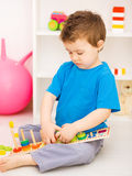 Boy is playing with building blocks Stock Images