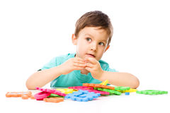 Boy is playing with building blocks Stock Photography