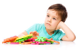 Boy is playing with building blocks Royalty Free Stock Photo