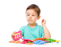 Boy is playing with building blocks Royalty Free Stock Photos