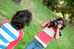 Boy playing with a camera Stock Photography