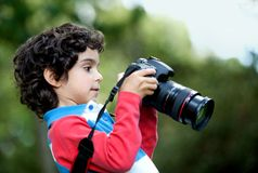 Boy playing with a camera Royalty Free Stock Photography