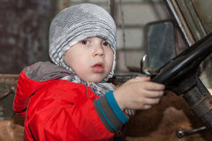 Boy playing in the car Royalty Free Stock Photography