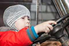 Boy playing in the car Stock Image