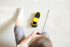 A boy playing with a car remote. In the room Royalty Free Stock Photography