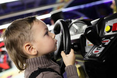 Boy playing with car simulator Stock Photos