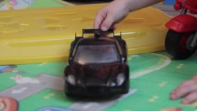 A boy playing with a car stock video