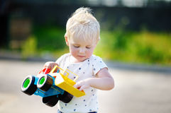 Boy playing with car toy Stock Photo