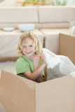 Boy playing with cardboard box Stock Photography