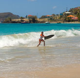 A boy playing in the caribbean sea Royalty Free Stock Photo