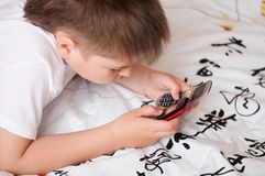 Boy playing on cell phones Royalty Free Stock Photos