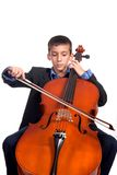 Boy playing Cello. Young boy student practicing playing musical instrument Cello Stock Photography