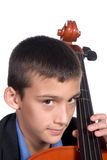 Boy playing Cello. Young boy student practicing playing musical instrument Cello Stock Photo