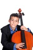Boy playing Cello. Young boy student practicing playing musical instrument Cello Royalty Free Stock Images