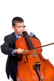 Boy playing Cello. Young boy student practicing playing musical instrument Cello Stock Photos