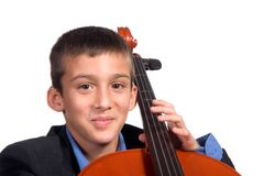 Boy playing Cello. Young boy student practicing playing musical instrument Cello Royalty Free Stock Photography