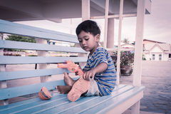 Boy playing on the chair Stock Image