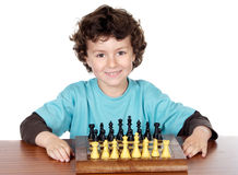 Boy playing the chess. Adorable boy playing the chess a over white background Royalty Free Stock Photos