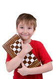 Boy playing chess Royalty Free Stock Image