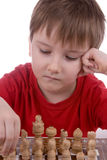 Boy playing chess Royalty Free Stock Images