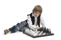 Boy playing a chess. Royalty Free Stock Image
