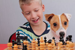 Boy playing chess. Focus on child's face Royalty Free Stock Images