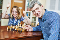 Boy playing chess at home Stock Photo